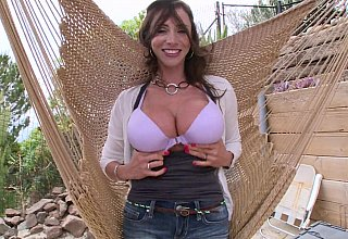 Outdoors tease from a MILF