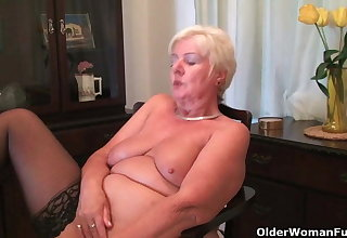 64 year old and British granny Sandie rubs her old pussy