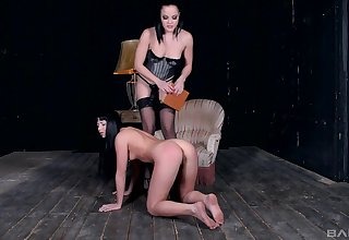 Lesbian femdom session with a strapon mistress anal pang her slave